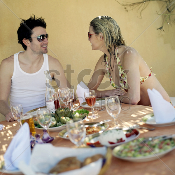 couple enjoying their meal stock photo