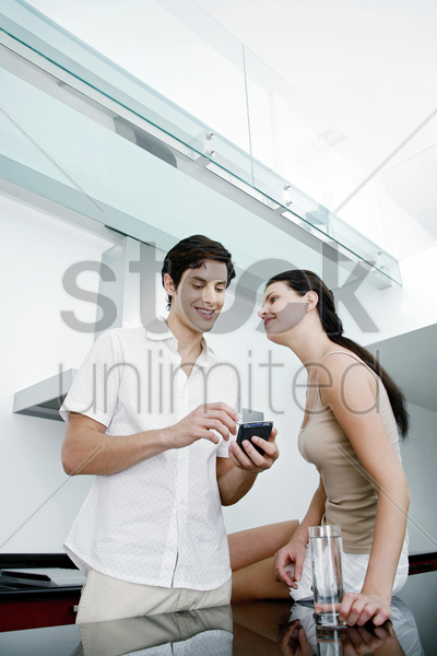 couple hanging out in the kitchen stock photo