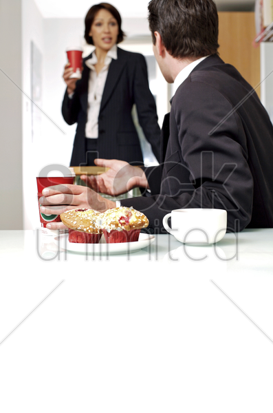 couple having breakfast before going to work stock photo