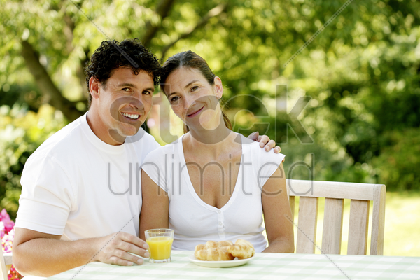 couple having breakfast together stock photo