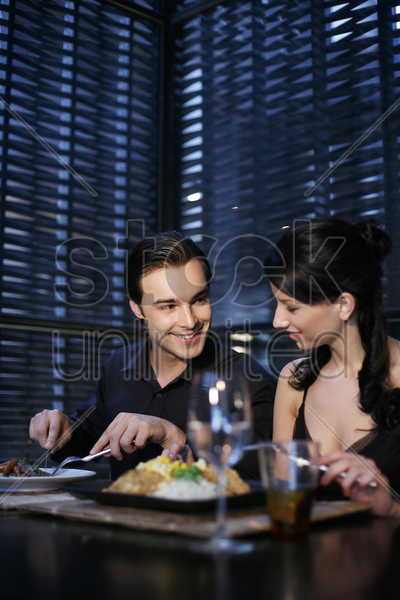 couple having dinner at a restaurant stock photo