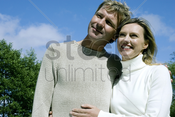 couple having fun in the park stock photo