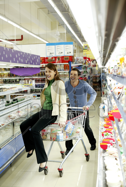 couple having fun shopping in the supermarket stock photo