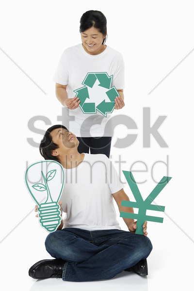 couple holding up various cut out shapes stock photo