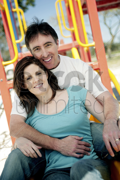 couple in the playground stock photo