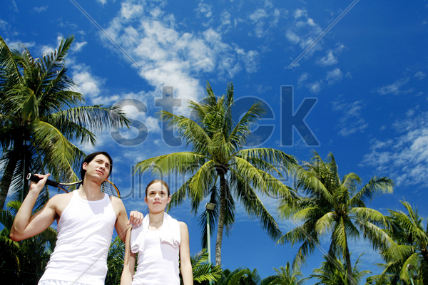 couple in the tennis court stock photo