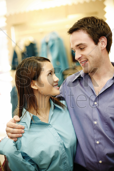 couple looking at each other stock photo