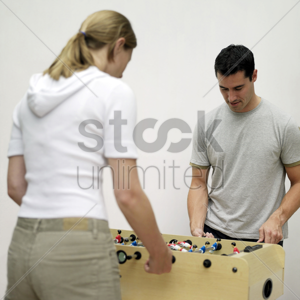 couple playing foosball stock photo