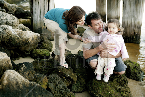 couple playing with their daughter stock photo