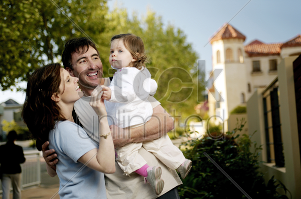couple playing with their lovely daughter stock photo