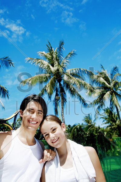 couple posing for camera in the tennis court stock photo