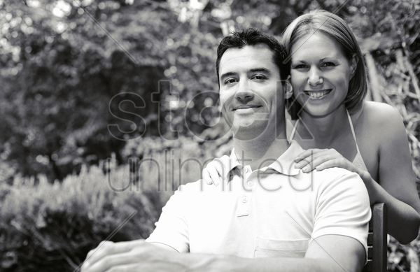 couple posing for the camera stock photo