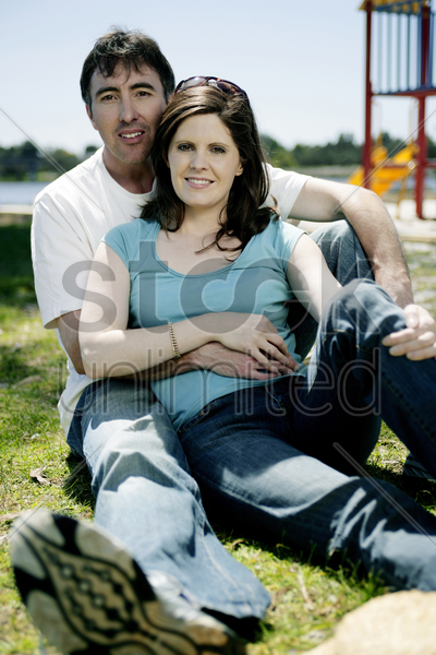 couple relaxing in the park stock photo