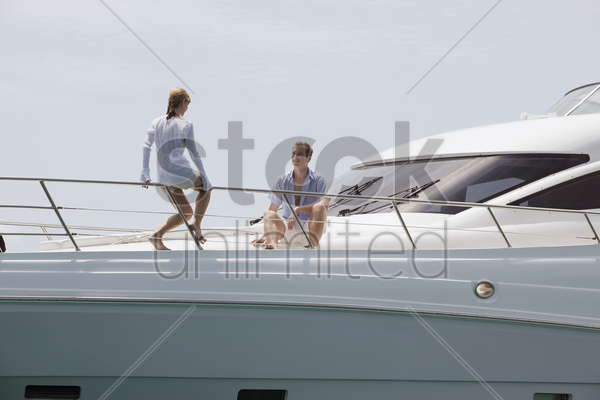 couple relaxing on yacht stock photo