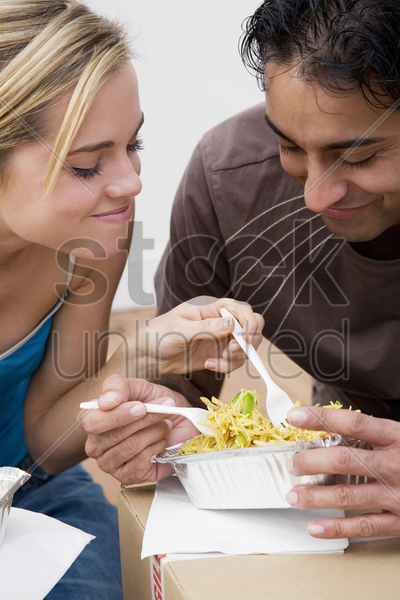couple sharing food stock photo