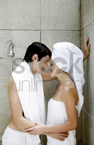 couple sharing intimate moment in the bathroom stock photo