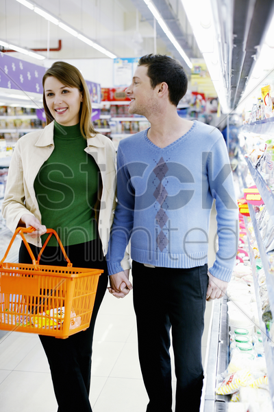 couple shopping in the supermarket stock photo