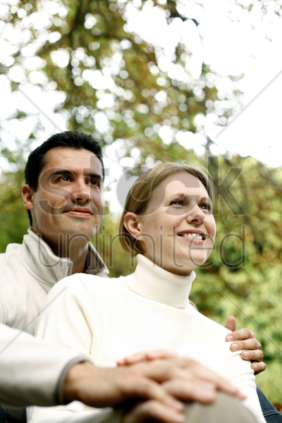 couple smiling while enjoying the outside view stock photo