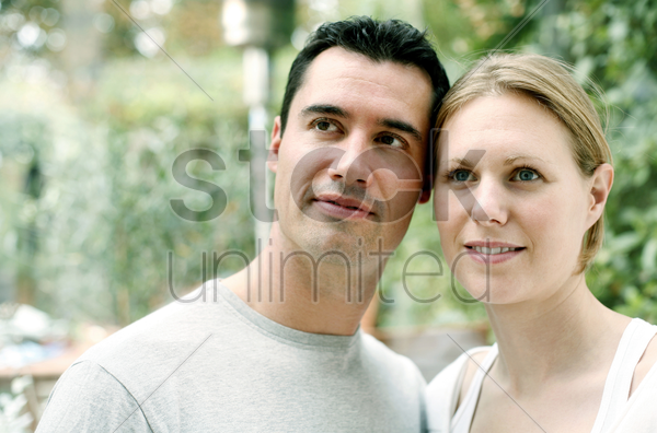couple smiling while looking up stock photo