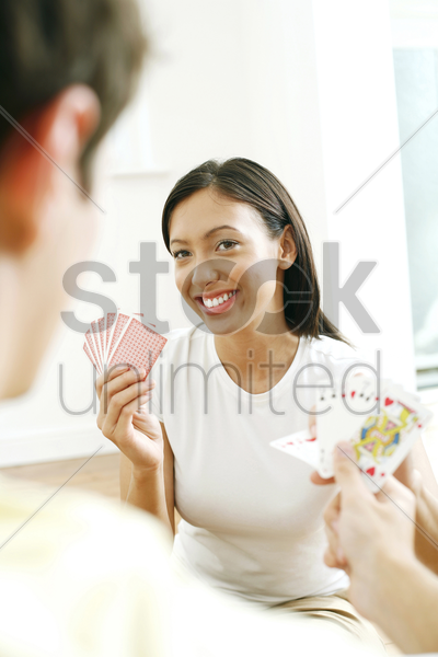 couple spending their free time playing cards stock photo