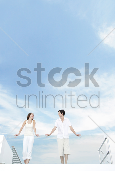couple standing at the balcony stock photo