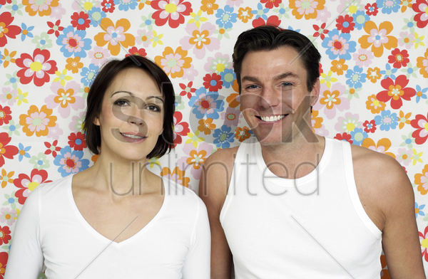 couple standing next to each other stock photo
