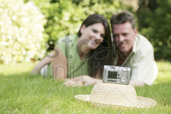 couple taking their picture in the park stock photo