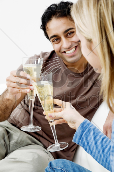 couple toasting drinks in their new house stock photo