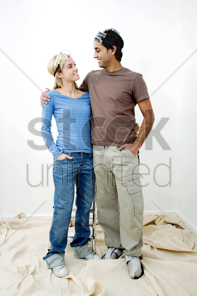 couple with protection goggles looking at each other stock photo