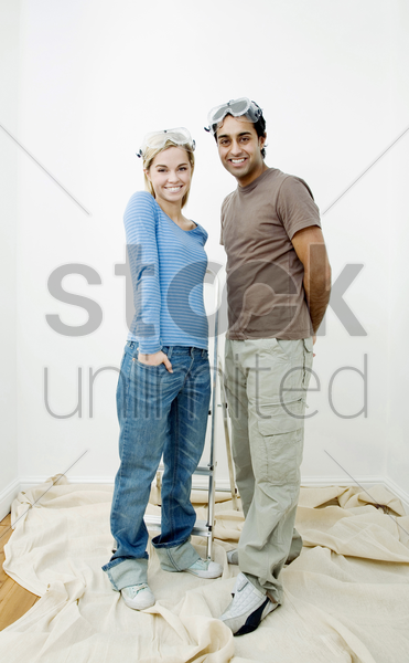 couple with protection goggles posing for the camera stock photo