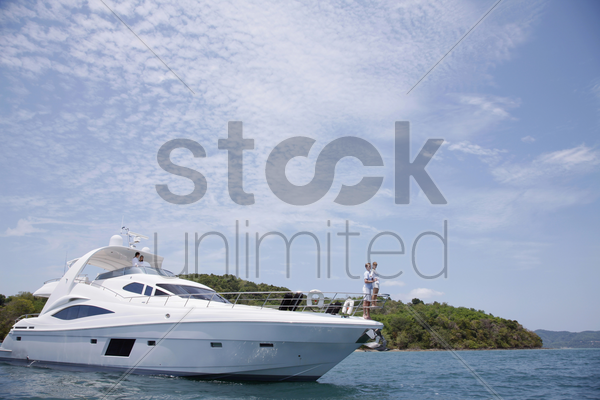 couples on yacht stock photo