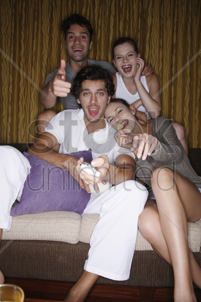 couples watching tv together stock photo