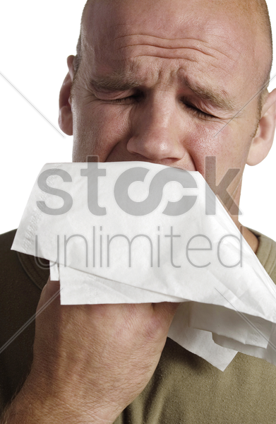 crying man blowing his nose stock photo