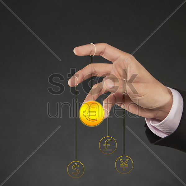 currency symbols hanging on human fingers stock photo