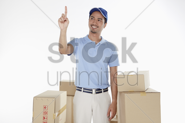 delivery man showing hand gesture stock photo