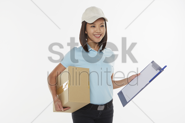 delivery person carrying a cardboard box and a clip file stock photo