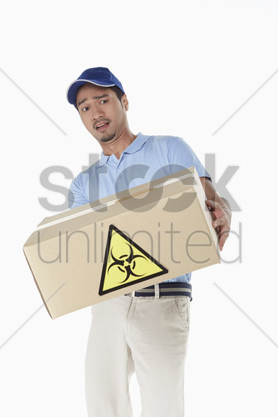 delivery person carrying a dangerous package stock photo