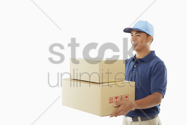 delivery person carrying cardboard boxes stock photo