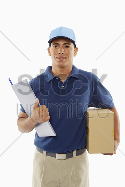 delivery person holding a cardboard box and a clipboard stock photo