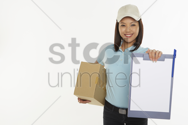 delivery person holding up a clip file stock photo
