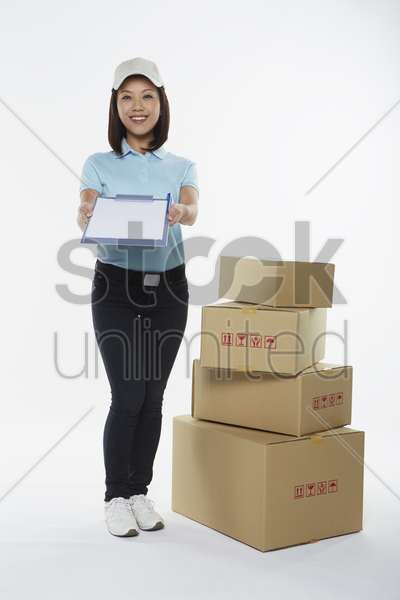 delivery person showing clip file stock photo