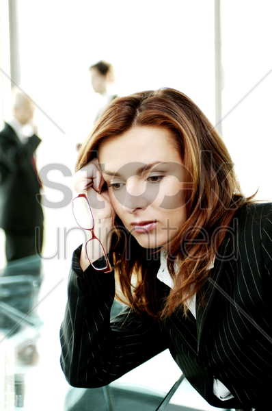 depressed businesswoman stock photo