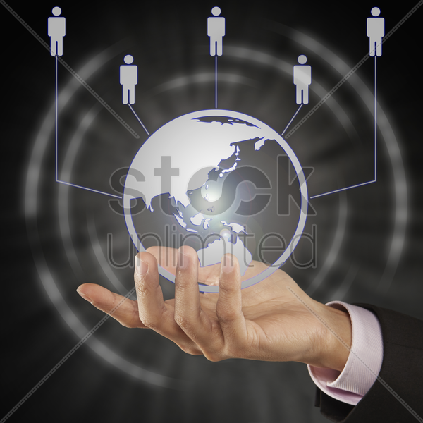digital globe and human figurines floating above hand stock photo