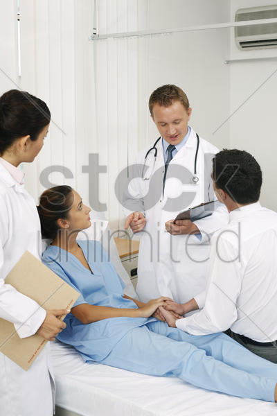 doctor giving explanation stock photo