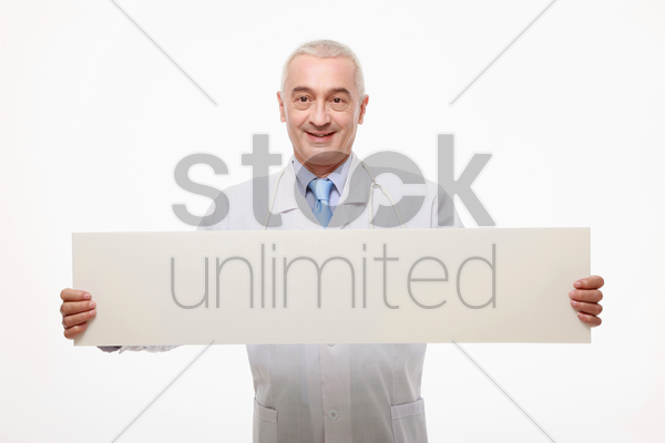 doctor holding a white placard stock photo