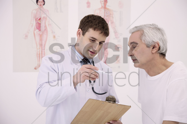 doctor showing patient temperature on the thermometer stock photo
