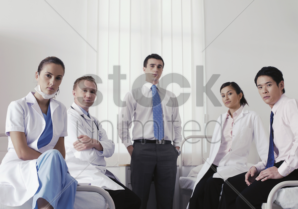 doctors and medical personnel posing for the camera stock photo