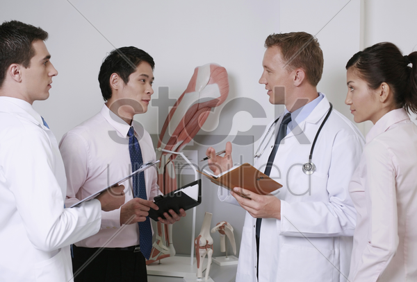 doctors having discussion stock photo