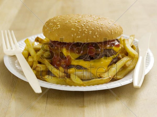 double cheeseburger and fries stock photo