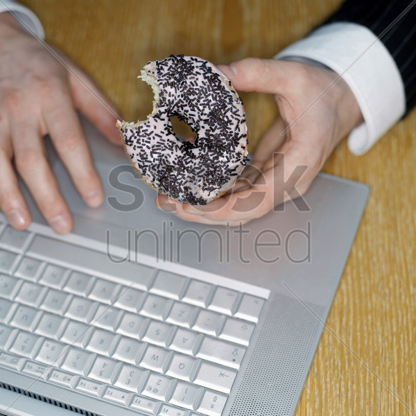 doughnut and laptop stock photo